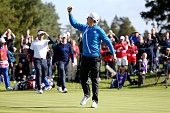 Justin Rose of Europe celebrates winning the first point for Europe on the 14th green during the Morning Fourballs of the 2014 Ryder Cup on the PGA...