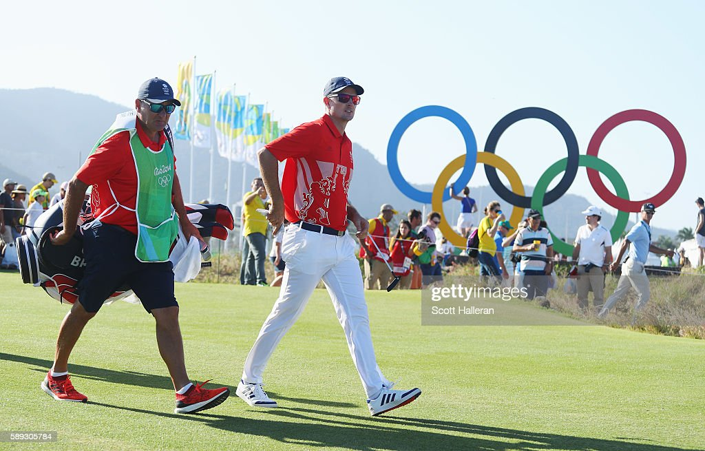 Justin Rose of Great Britain and his caddie Mark Fulcher walk to the 17th green during the third round of the golf on Day 8 of the Rio 2016 Olympic...