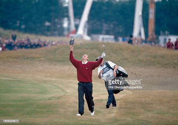 Justin Rose of Great Britain celebrates after chipping in for a birdie at the 18th hole during the final round of the British Open Golf Championship...