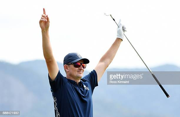 Justin Rose of Great Britain celebrates after hitting a hole in one on the fourth hole during the first round of men's golf on Day 6 of the Rio 2016...