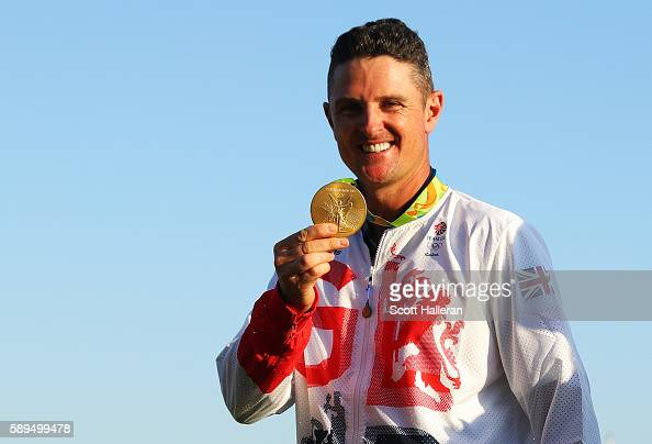 Justin Rose of Great Britain celebrates with the gold medal after winning in the final round of men's golf on Day 9 of the Rio 2016 Olympic Games at...