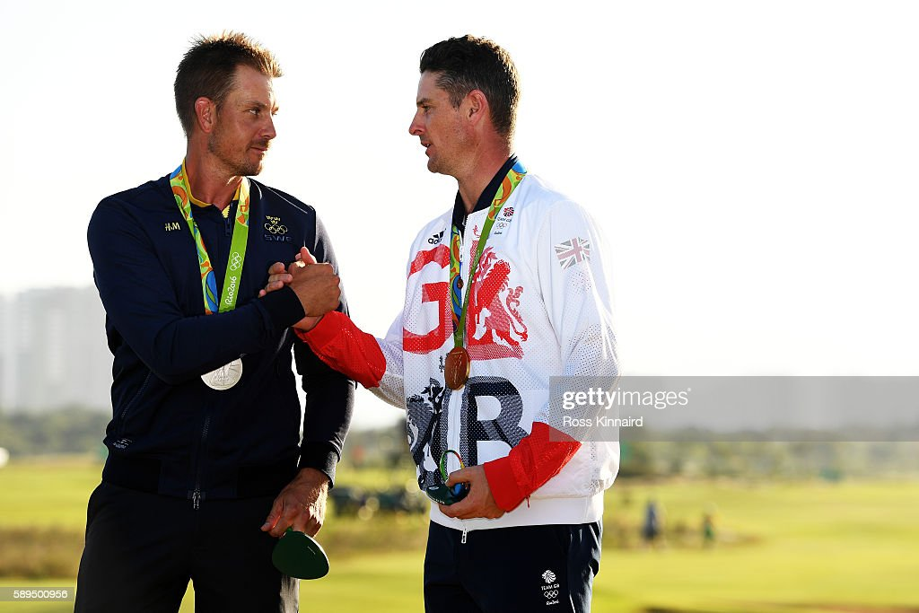 Justin Rose (R) of Great Britain celebrates with the gold medal and Henrik Stenson of Sweden, silver medal, after the final round of men's golf on Day 9 of the Rio 2016 Olympic Games at the Olympic Golf Course on August 14, 2016 in Rio de Janeiro, Brazil.