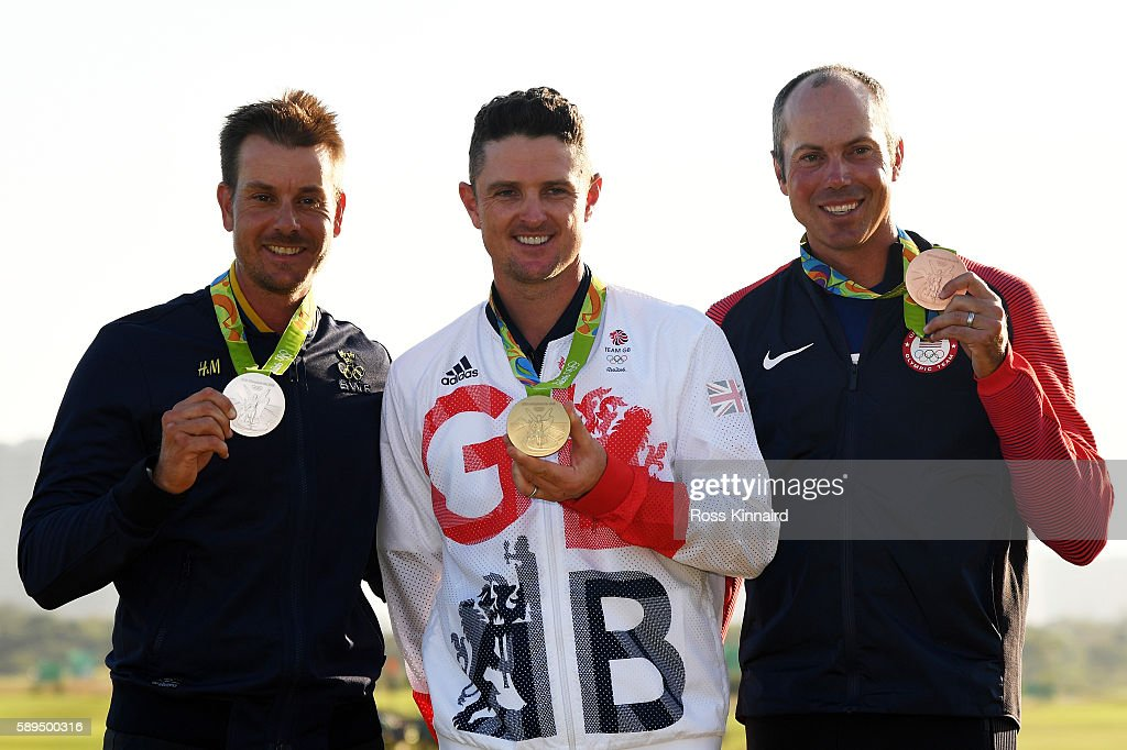 Justin Rose (C) of Great Britain celebrates with the gold medal, Henrik Stenson (L) of Sweden, silver medal, and Matt Kuchar of the United States, bronze medal, after the final round of men's golf on Day 9 of the Rio 2016 Olympic Games at the Olympic Golf Course on August 14, 2016 in Rio de Janeiro, Brazil.
