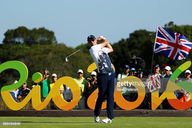 Justin Rose of Great Britain plays his shot from the 16th tee during the final round of men's golf on Day 9 of the Rio 2016 Olympic Games at the...