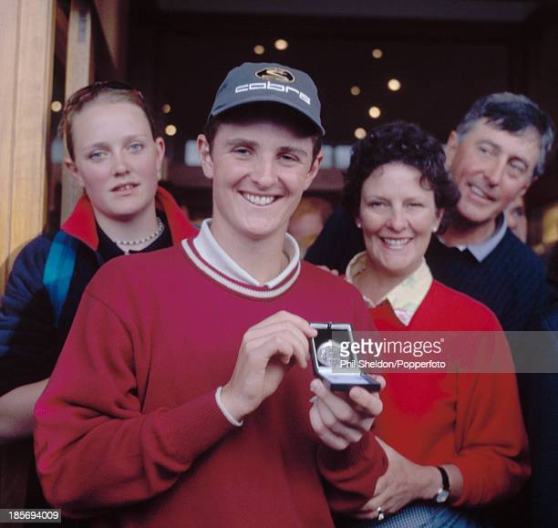 Justin Rose of Great Britain with his parents Ken and Annie and his sister Margaret after Rose won the silver medal for the lowest amateur score in...