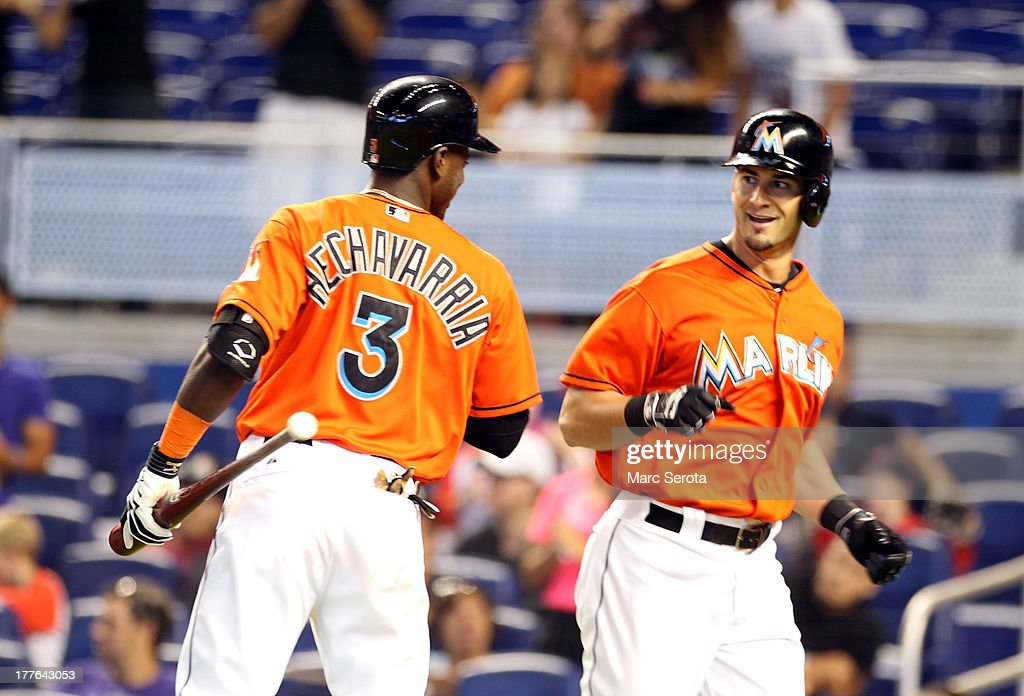 <a gi-track='captionPersonalityLinkClicked' href=/galleries/search?phrase=Justin+Ruggiano&family=editorial&specificpeople=4536828 ng-click='$event.stopPropagation()'>Justin Ruggiano</a> #20 of the Miami Marlins celebrates a home run with teammate <a gi-track='captionPersonalityLinkClicked' href=/galleries/search?phrase=Adeiny+Hechavarria&family=editorial&specificpeople=6926508 ng-click='$event.stopPropagation()'>Adeiny Hechavarria</a> #3 against the Colorado Rockies at Marlins Park on August 25, 2013 in Miami, Florida.