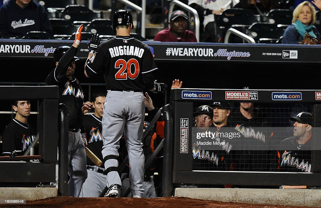 <a gi-track='captionPersonalityLinkClicked' href=/galleries/search?phrase=Justin+Ruggiano&family=editorial&specificpeople=4536828 ng-click='$event.stopPropagation()'>Justin Ruggiano</a> #20 of the Miami Marlins celebrates with teammates after scoring a home run in the fourth inning of game two of a doubleheader with the New York Mets on September 14, 2013 at Citi Field in the Flushing neighborhood of the Queens borough of New York City.