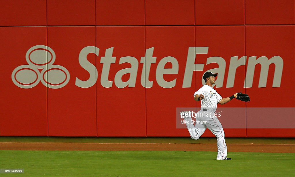 <a gi-track='captionPersonalityLinkClicked' href=/galleries/search?phrase=Justin+Ruggiano&family=editorial&specificpeople=4536828 ng-click='$event.stopPropagation()'>Justin Ruggiano</a> #20 of the Miami Marlins makes a catch during a game against the Philadelphia Phillies at Marlins Park on May 20, 2013 in Miami, Florida.