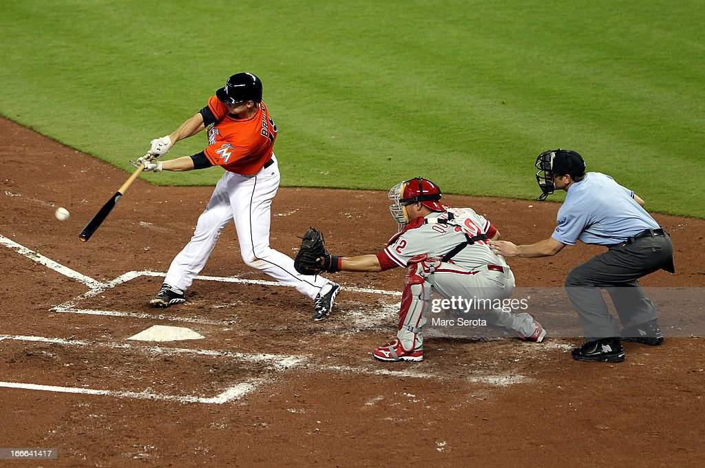 Justin Ruggioni of the Miami Marlins singles against the Philadelphia Phillies in the seventh inning at Marlins Park on April 14, 2013 in Miami, Florida. The Phillies defeated the Marlins 2-1.