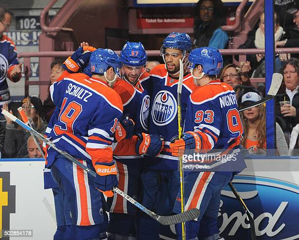 Justin Schultz Benoit Pouliot Darnell Nurse and Ryan NugentHopkins of the Edmonton Oilers celebrate after a goal during a game against the Los...