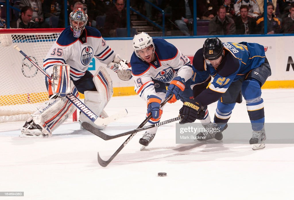 <a gi-track='captionPersonalityLinkClicked' href=/galleries/search?phrase=Justin+Schultz&family=editorial&specificpeople=5370958 ng-click='$event.stopPropagation()'>Justin Schultz</a> #19 of the Edmonton Oilers and <a gi-track='captionPersonalityLinkClicked' href=/galleries/search?phrase=Patrik+Berglund&family=editorial&specificpeople=540481 ng-click='$event.stopPropagation()'>Patrik Berglund</a> #21 of the St. Louis Blues battle for the puck in an NHL game on March 26, 2013 at Scottrade Center in St. Louis, Missouri.