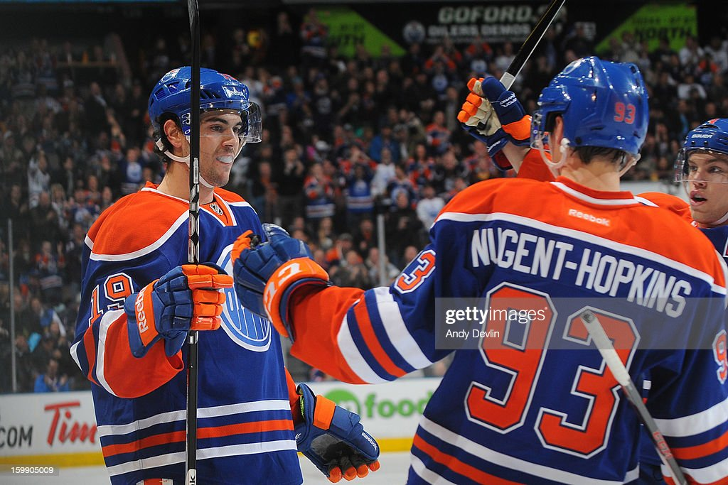 Justin Schultz #19 of the Edmonton Oilers celebrates with team mates after scoring his first NHL goal against the San Jose Sharks at Rexall Place on January 22, 2013 in Edmonton, Alberta, Canada.