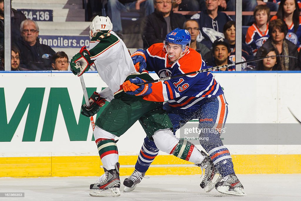 Justin Schultz #19 of the Edmonton Oilers checks <a gi-track='captionPersonalityLinkClicked' href=/galleries/search?phrase=Torrey+Mitchell&family=editorial&specificpeople=4504539 ng-click='$event.stopPropagation()'>Torrey Mitchell</a> #17 of the Minnesota Wild during an NHL game at Rexall Place on February 21, 2013 in Edmonton, Alberta, Canada.