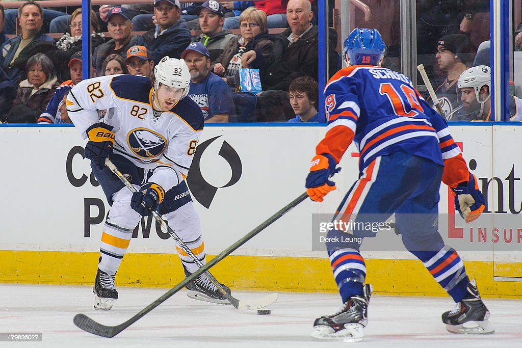 Justin Schultz #19 of the Edmonton Oilers defends against Marcus Foligno #82 of the Buffalo Sabres during an NHL game at Rexall Place on March 20, 2014 in Edmonton, Alberta, Canada. The Sabres defeated the Oilers 3-1.