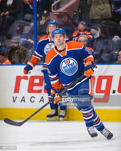 Justin Schultz of the Edmonton Oilers in action against the Calgary Flames during an NHL game at Rexall Place on March 22 2014 in Edmonton Alberta...