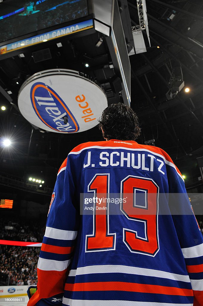 Justin Schultz #19 of the Edmonton Oilers lines up for the singing of the national anthem in a game against the Los Angeles Kings at Rexall Place on January 24, 2013 in Edmonton, Alberta, Canada.
