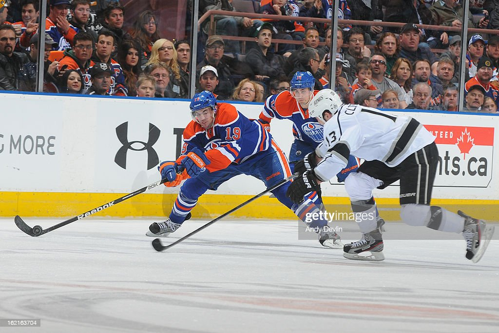 Justin Schultz #19 of the Edmonton Oilers reaches for the puck in a game against the Los Angeles Kings on February 19, 2013 at Rexall Place in Edmonton, Alberta, Canada.