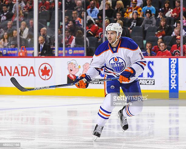 Justin Schultz of the Edmonton Oilers skates against the Calgary Flames during a preseason NHL game at Scotiabank Saddledome on September 21 2015 in...