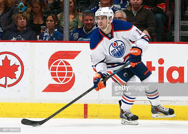 Justin Schultz of the Edmonton Oilers skates up ice with the puck during their NHL game against the Vancouver Canucks at Rogers Arena October 11 2014...