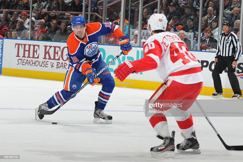 <a gi-track='captionPersonalityLinkClicked' href=/galleries/search?phrase=Justin+Schultz&family=editorial&specificpeople=5370958 ng-click='$event.stopPropagation()'>Justin Schultz</a> #19 of the Edmonton Oilers takes a shot from the point in a game against the Detroit Red Wings on March 15 2013 at Rexall Place in Edmonton, Alberta, Canada.