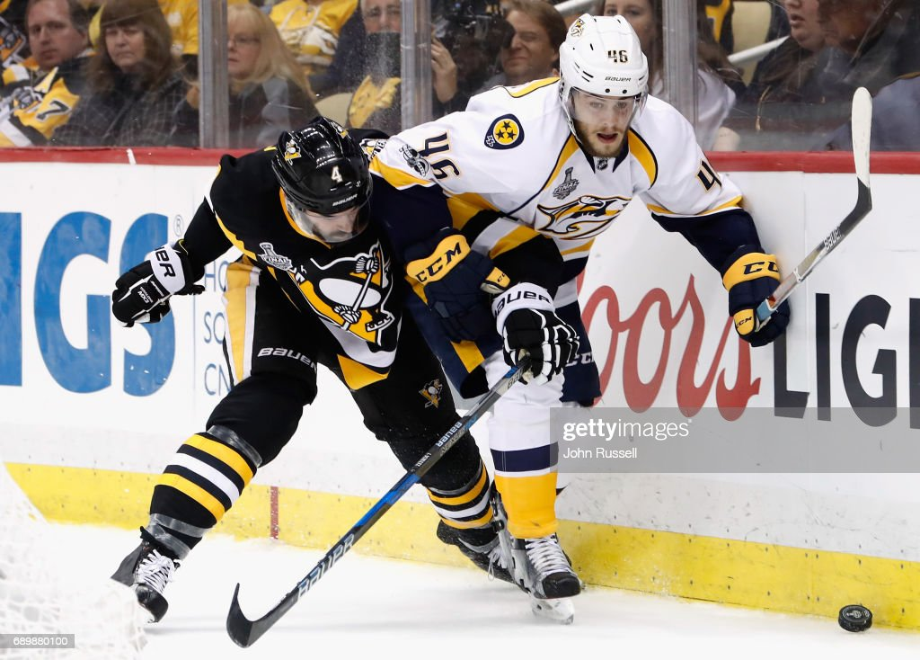 Justin Schultz #4 of the Pittsburgh Penguins battles with Pontus Aberg #46 of the Nashville Predators at the boards during the third period of Game One of the 2017 NHL Stanley Cup Final at PPG Paints Arena on May 29, 2017 in Pittsburgh, Pennslyvannia. The Pittsburgh Penguins won the game 5-3.