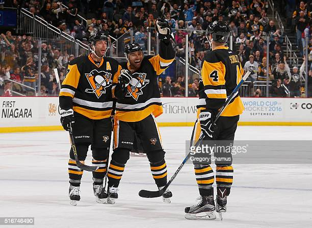Justin Schultz of the Pittsburgh Penguins celebrates his goal with Matt Cullen and Trevor Daley of the Pittsburgh Penguins during the third period...