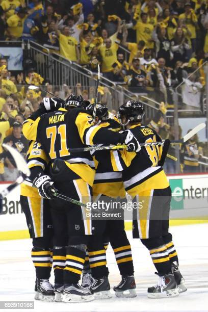 Justin Schultz of the Pittsburgh Penguins celebrates with teammates after scoring a goal in the first period against the Nashville Predators in Game...