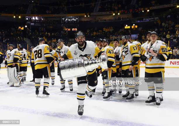 Justin Schultz of the Pittsburgh Penguins celebrates with the Stanley Cup following a victory over the Nashville Predators in Game Six of the 2017...