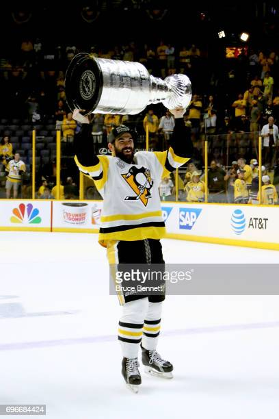 Justin Schultz of the Pittsburgh Penguins of the Pittsburgh Penguins celebrates with the Stanley Cup trophy after defeating the Nashville Predators...