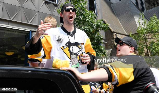 Justin Schultz of the Pittsburgh Penguins rides in the Victory Parade and Rally on June 14 2017 in Pittsburgh Pennsylvania