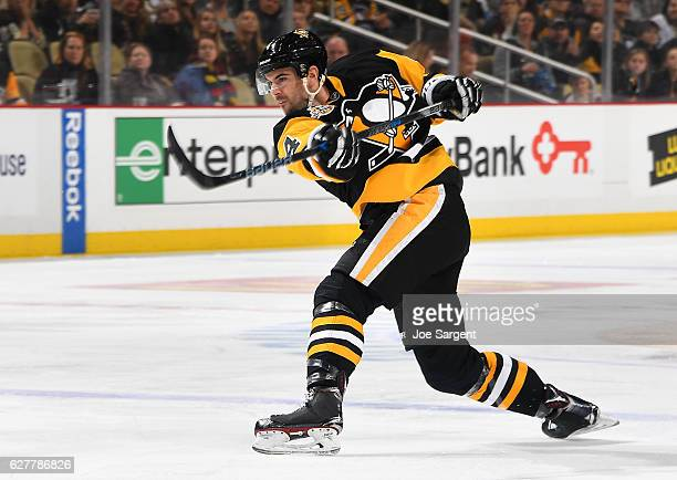 Justin Schultz of the Pittsburgh Penguins takes a shot during the game against the Dallas Stars at PPG Paints Arena on December 1 2016 in Pittsburgh...