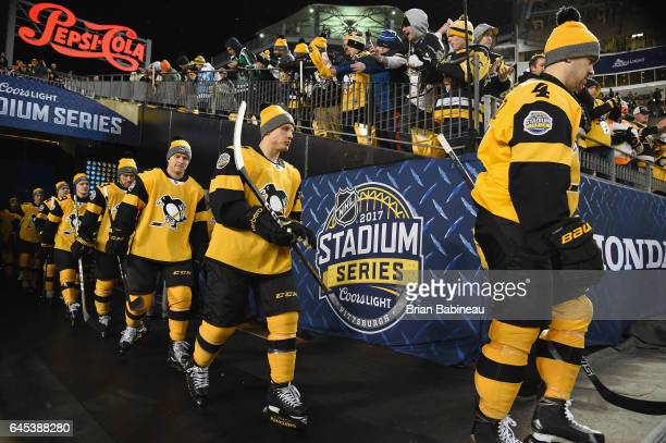 Justin Schultz Steve Oleksy Chad Ruhwedel and their Pittsburgh Penguins teammates make their way to the ice surface for warmup prior to the 2017...