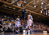 Justin Sears of the Yale Bulldogs dunks over Matt Jones and Derryck Thornton of the Duke Blue Devils during their game at Cameron Indoor Stadium on...