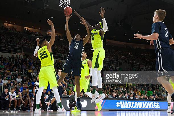 Justin Sears of the Yale Bulldogs puts up a shot against Al Freeman and Johnathan Motley of the Baylor Bears during the first round of the 2016 NCAA...