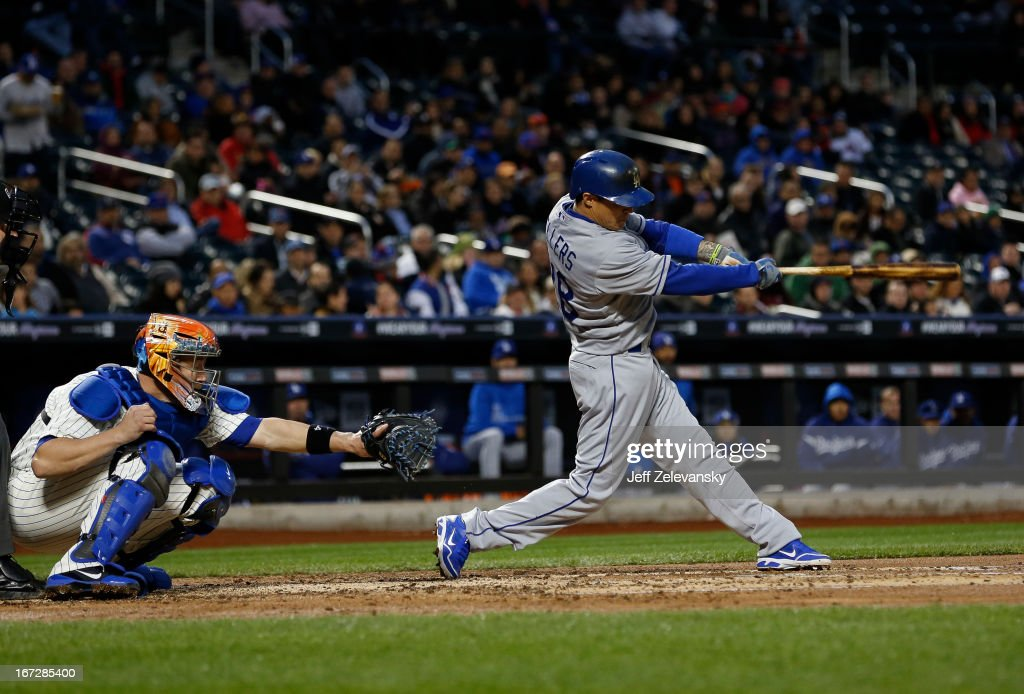 Justin Sellers #28 of the Los Angeles Dodgers connects for an RBI single in front of <a gi-track='captionPersonalityLinkClicked' href=/galleries/search?phrase=John+Buck&family=editorial&specificpeople=213730 ng-click='$event.stopPropagation()'>John Buck</a> #44 of the New York Mets in the second inning at Citi Field in the Flushing neighborhood of the Queens borough of New York City.