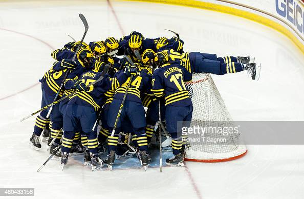 Justin Selman of the Michigan Wolverines hangs over the back of the net before NCAA hockey against the Boston College Eagles at Kelley Rink on...