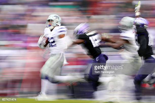 Justin Silmon of the Kansas State Wildcats carries the ball against Jeff Gladney of the TCU Horned Frogs in the first half at Amon G Carter Stadium...