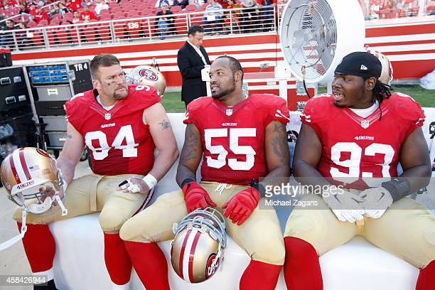 Justin Smith Ahmad Brooks and Ian Williams of the San Francisco 49ers sit on the bench during the game against the St Louis Rams at Levi Stadium on...