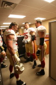 Justin Smith Alex Boone and Joe Staley of the San Francisco 49ers stand in the locker room prior to the game against the Washington Redskins at FedEx...