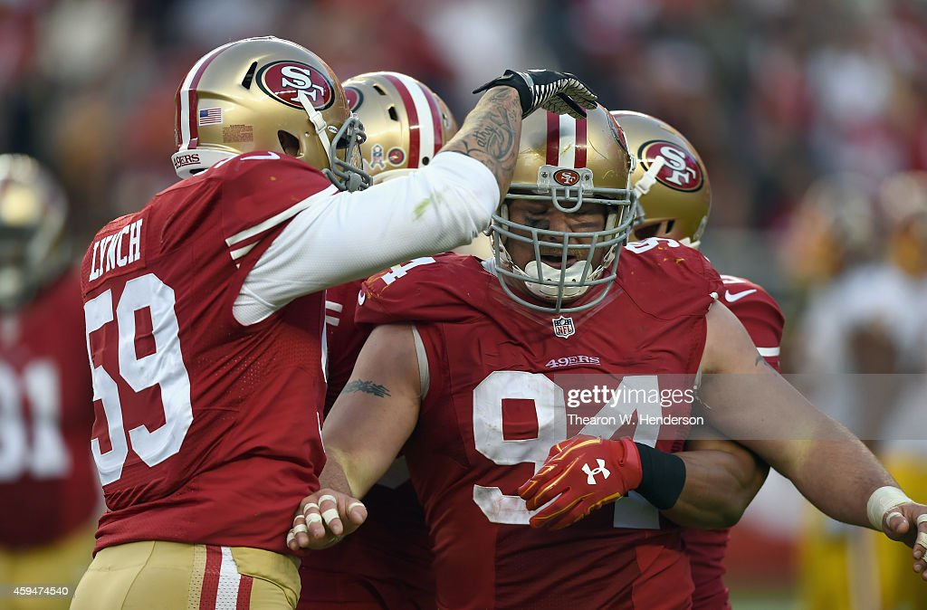Justin Smith #94 of the San Francisco 49ers celebrates a touchdown with Aaron Lynch #59 against the Washington Redskins at Levi's Stadium on November 23, 2014 in Santa Clara, California.