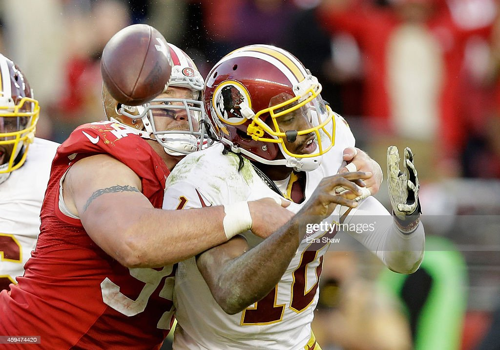 Justin Smith #94 of the San Francisco 49ers forces a fumble from Robert Griffin III #10 of the Washington Redskins in the fourth quarter at Levi's Stadium on November 23, 2014 in Santa Clara, California.