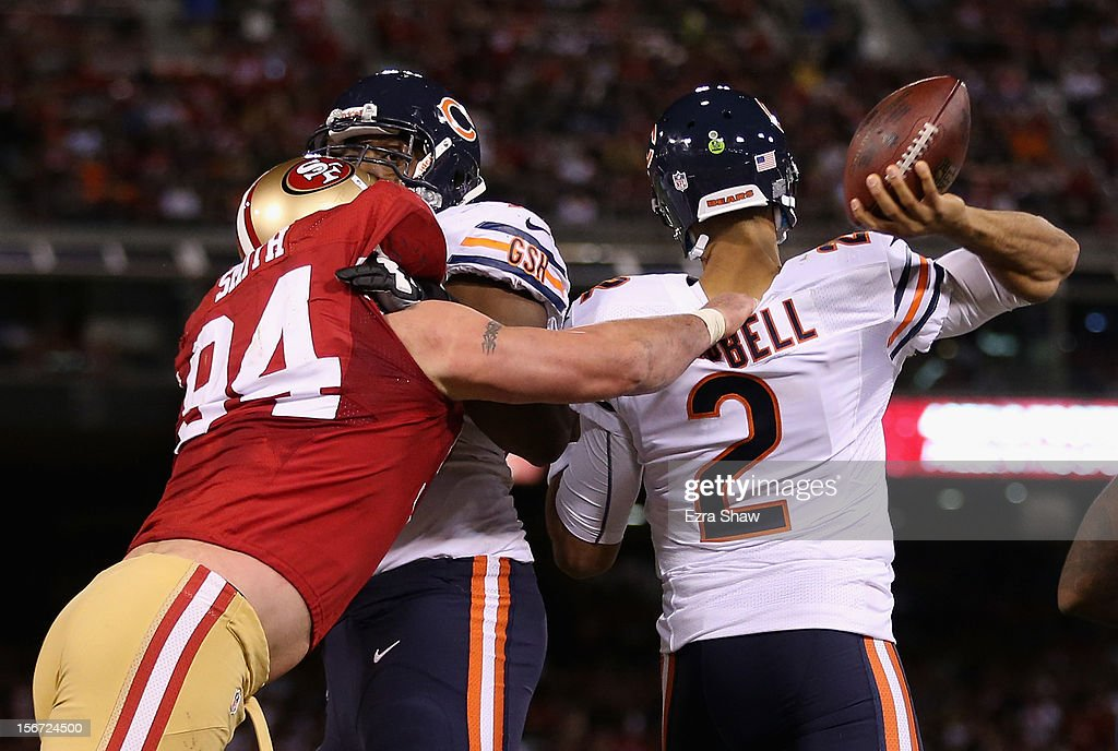 Justin Smith #94 of the San Francisco 49ers grabs the jersey of Jason Campbell #2 of the Chicago Bears as he tries to pass the ball at Candlestick Park on November 19, 2012 in San Francisco, California.