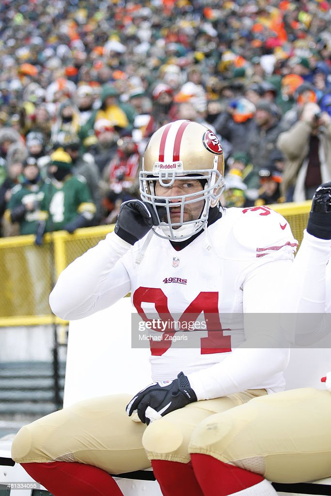 Justin Smith #94 of the San Francisco 49ers sits on the bench prior to the game against the Green Bay Packers at Lambeau Field on January 5, 2014 in Green Bay, Wisconsin. The 49ers defeated the Packers 23-20.