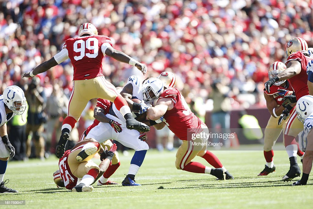 Justin Smith #94, Patrick Willis #52, NaVorro Bowman #53 and Aldon Smith #99 of the San Francisco 49ers tackle Trent Richardson #34 of the Indianapolis Colts during the game at Candlestick Park on September 22, 2013 in San Francisco, California. The Colts defeated the 49ers 27-7.