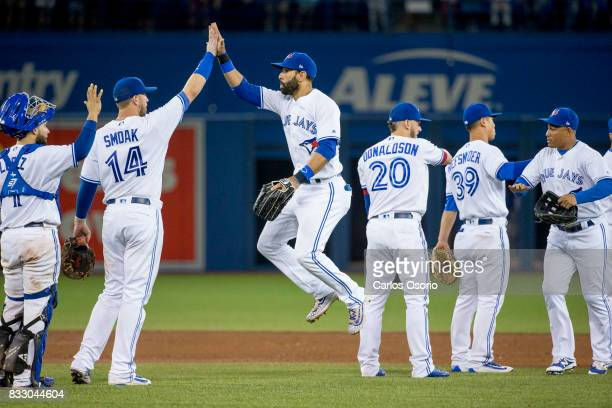 TORONTO ON AUGUST 16 Justin Smoak and Jose Bautista of the Blue Jays celebrate their 32 win over the Tampa Bay Rays at the Rogers Centre on August 16...