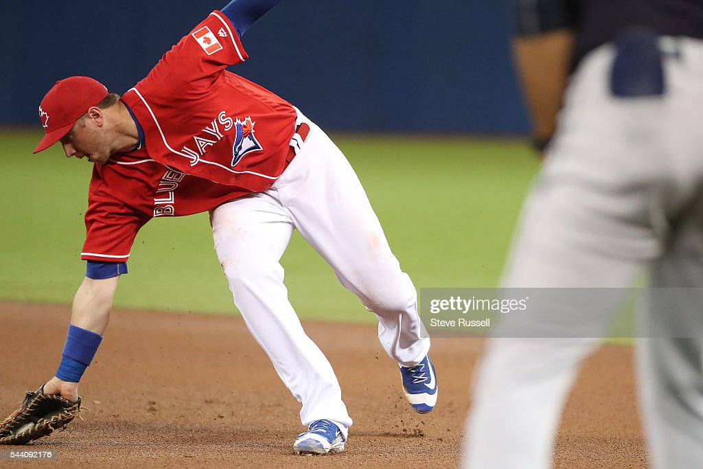 TORONTO, ON- JULY 1 - Justin Smoak hauls in a grounder as the Toronto Blue Jays play the Cleveland Indians on Canada Day at the Rogers Centre in Toronto. July 1, 2016.