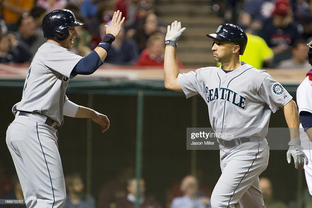 <a gi-track='captionPersonalityLinkClicked' href=/galleries/search?phrase=Justin+Smoak&family=editorial&specificpeople=2350583 ng-click='$event.stopPropagation()'>Justin Smoak</a> #17 of the Seattle Mariners celebrates with <a gi-track='captionPersonalityLinkClicked' href=/galleries/search?phrase=Raul+Ibanez&family=editorial&specificpeople=206118 ng-click='$event.stopPropagation()'>Raul Ibanez</a> #28 after Ibanez hit a two-run home run in the sixth inning against the Cleveland Indians at Progressive Field on May 17, 2013 in Cleveland, Ohio.