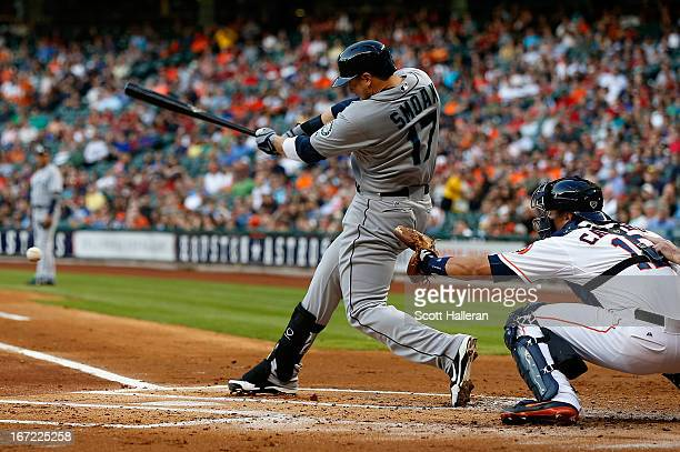 Justin Smoak of the Seattle Mariners drives in a run in the first inning of the game against the Houston Astros at Minute Maid Park on April 22 2013...