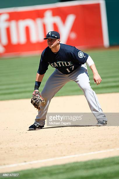 Justin Smoak of the Seattle Mariners fields during the game against the Oakland Athletics at Oco Coliseum on April 6 2014 in Oakland California The...