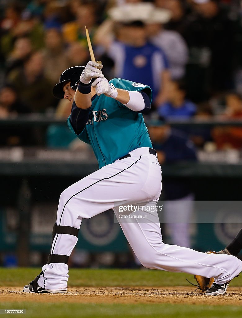 Justin Smoak #17 of the Seattle Mariners hits a broken-bat single in the sixth inning against the Baltimore Orioles at Safeco Field on April 29, 2013 in Seattle, Washington.